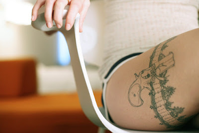 thigh tattoo art design for sexy girl with animal tattoo, dragon tattoo, flower tattoo and gun tattoo