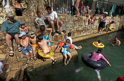 Israeli children enjoy the spring water of Nahal Prat, in the Judea Desert near the West Bank settlement of Alon, east of Jerusalem