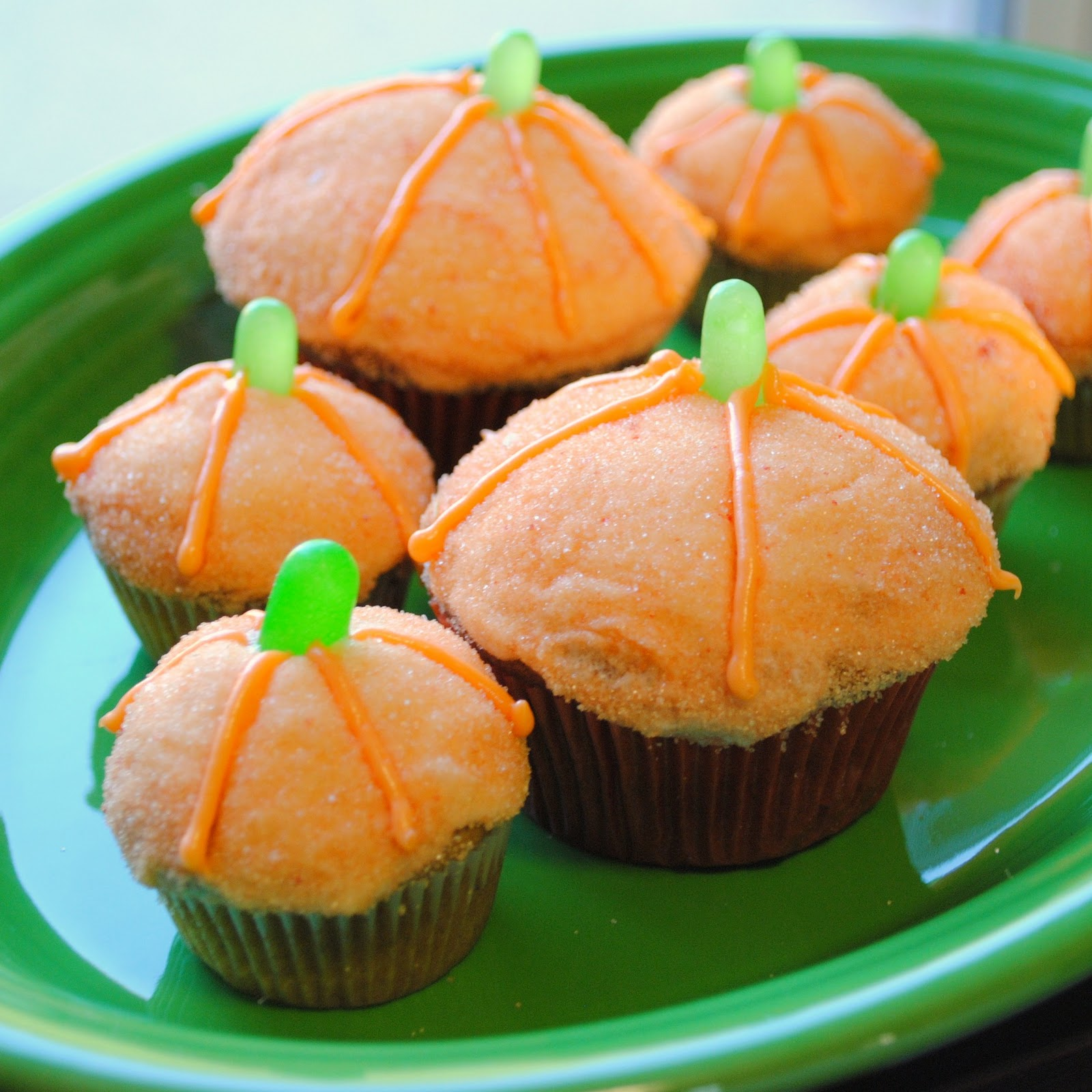 These are pumpkin cupcakes with cream cheese frosting rolled in orange ...