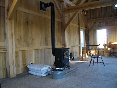 No wood shop would be complete without a wood stove. There are always  scraps to burn for heat in a wood shop. I decided to go with the