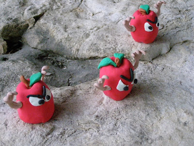 three apples, clay figures