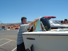 Tyler using my best beach towel to clean his new motor!