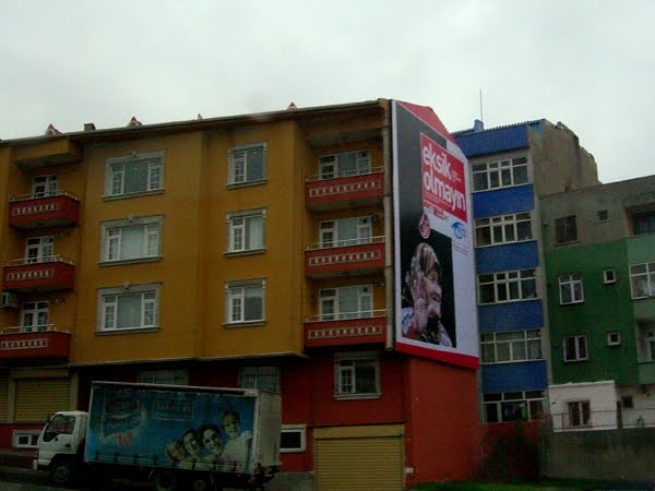 Colorfully painted apartment buildings off the side of the highway in Istanbul.