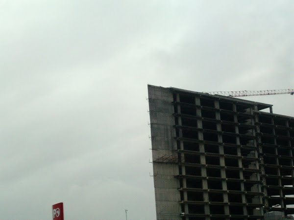 Concrete building under construction in Istanbul on a rainy day.