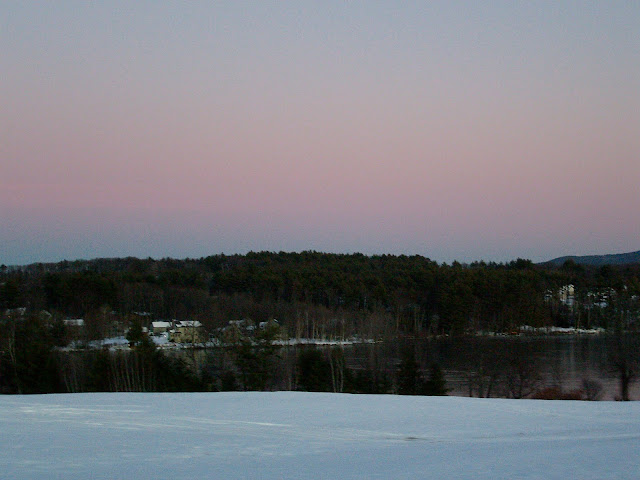 Lake near Meredith, New Hampshire at sunset in winter.