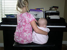 Olivia teaching piano to Chloe
