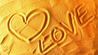 Heart Shape and Love Text on Sand HD Valentines Day Wallpaper