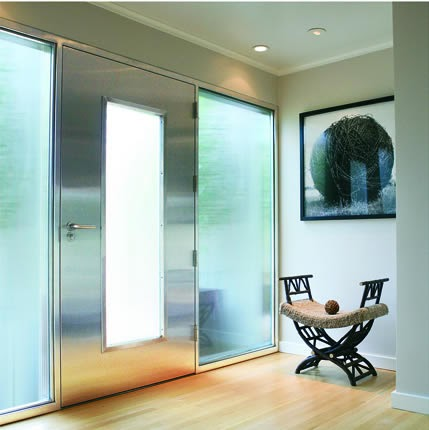 Arquitectura de casas puertas de acero inoxidable y vidrio for Puertas de vidrio para casas