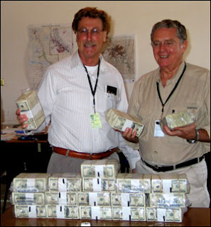 US officials in Iraq pose with shipment of cash