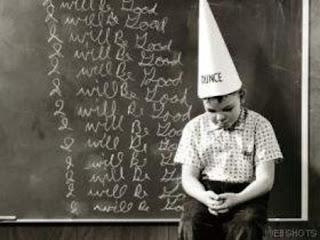 Boy in dunce cap
