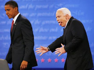 McCain mugs for the camera at the debate, sticking his tongue out