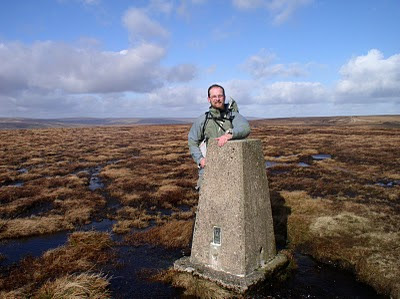 Standing by the trig point on Fendrith Hill in the North Pennines - many of the trig points in the North Pennines can only be reached by a long march across pathless and often rough terrain
