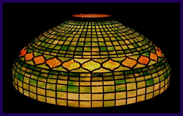 Views from north cecil 1915 tiffany jeweled geometric lamp shade tiffany studios new york jeweled geometric leaded glass lamp shade multi hued green geometric glass background which shades from soft green to a much aloadofball Gallery