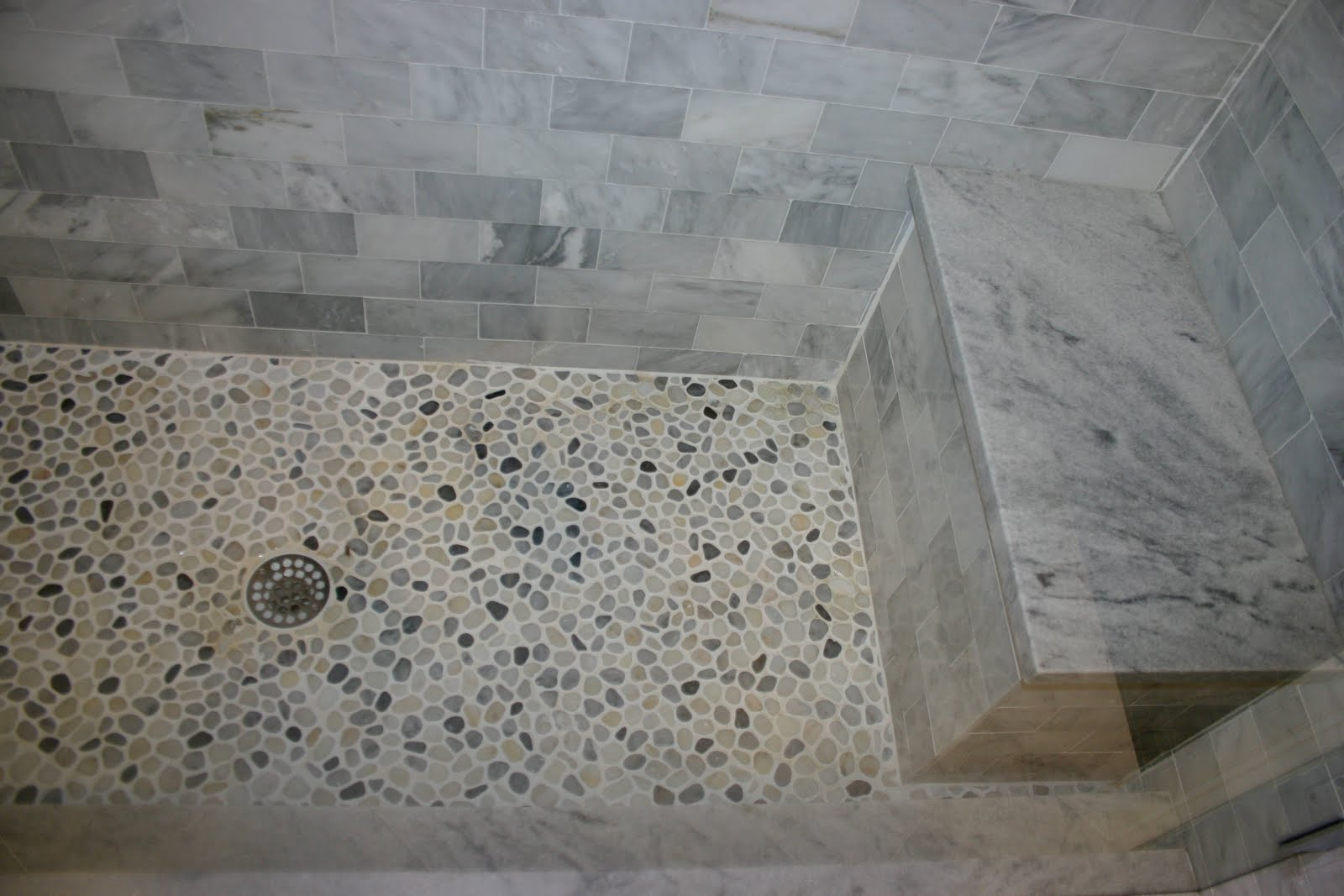 Bathroom design pebble tiles home decorating for Tile shower floor ideas