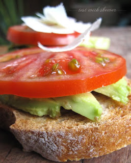 avocado on toast with tomato and cheese