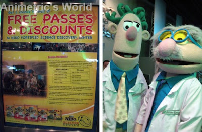 Nido Science Discovery promotional poster and official mascots Dr. Bunsen Burner with Sidekick