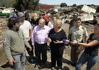 >quakes in Chile and Haiti