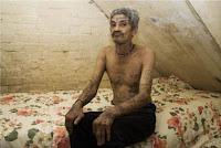 Membro de gangue africana tatuado