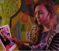 georgina looks at a rough copy of her new magazine invisible