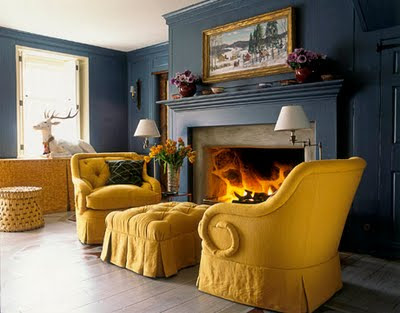 living-room_traditional-tufted-chair-ottoman-mustard-yellow-peacock-blue-gold_jeffrey-billhuber-house-beautiful.jpg