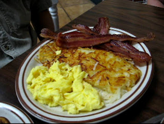 Click to enlarge – Full Belly Egg plate – two scrambled eggs, hash browns and 4 strips of crispy bacon.