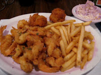 Click to enlarge - All you can eat shrimp, first round, with French fries and hush puppies.