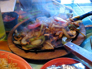Hot sizzling fajitas delivered to the table