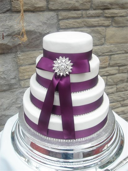 Picture of 4 Tier White Wedding Cake with Purple Ribbon by Any Excuse