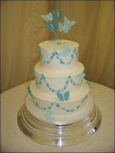 Picture of 3 Tier White Wedding Cake with Blue Butterflies