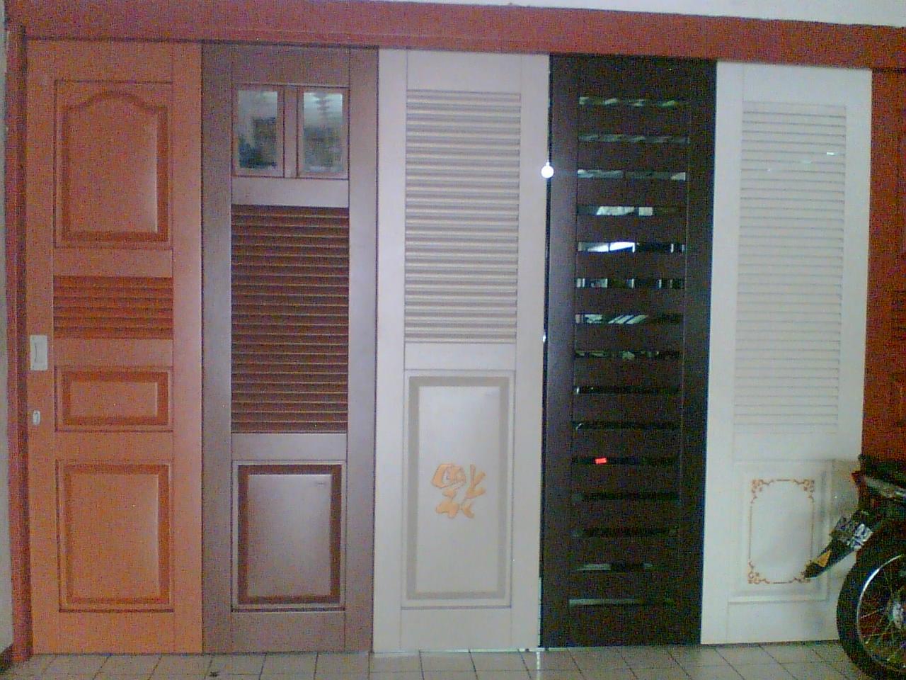 PINTU GARASI WINA JEMBER: contoh pintu besi garasi