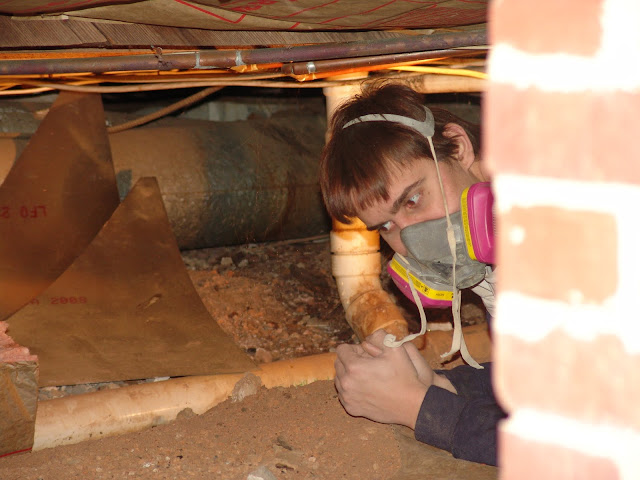 crawling under a house