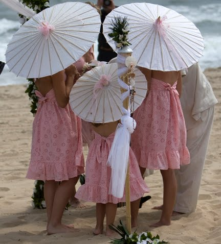THE PERFECT ACCESSORY FOR BEACH WEDDINGS Colored Parasols not only are a