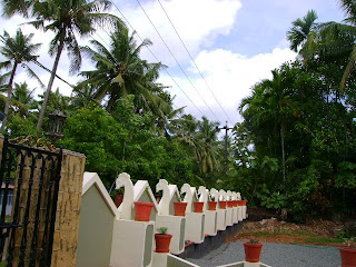 Picture shows inside view of compound wall guarded by white arayannams ...