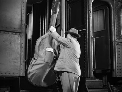 Alfred Hitchcock in Strangers on a Train (1951)