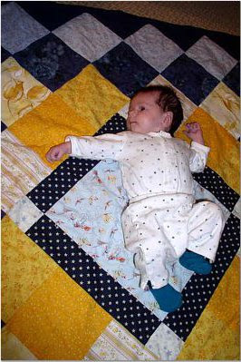 Nighttime side of quilt with baby niece