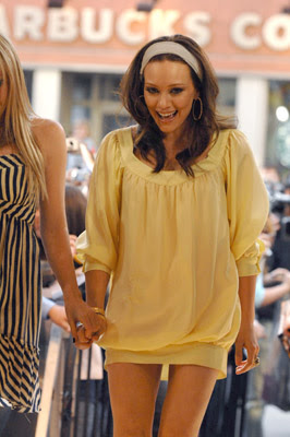 Hillary Duff was in Toronto promoting her third studio CD, Dignity  wear a yellow dress