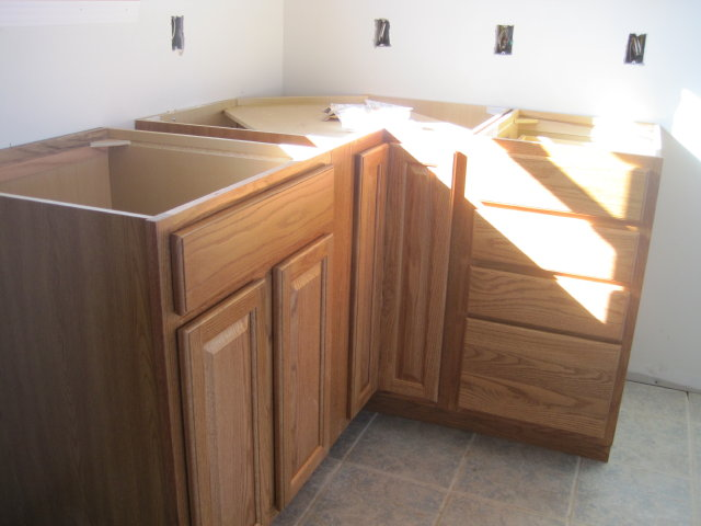 this is the bottom a cupboard 4 drawers and small sink base  actually there is room for a 3   pull out spice drawer that will be installed next to the sink     bluegrass mom u0027s perspective   kitchen cabinets installed     rh   bluegrassjill blogspot com