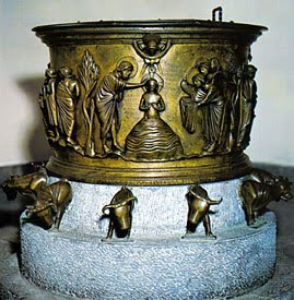 12 oxen under font represent 12 apostles. Baptism of  Christ, angels with garments. Latin script