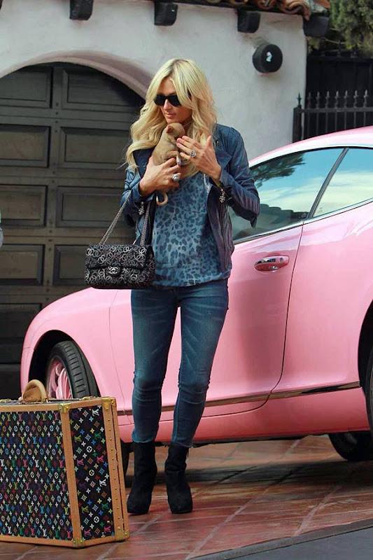 Paris Hilton  Shows us Her Little Puppy amp Pink Car hot images