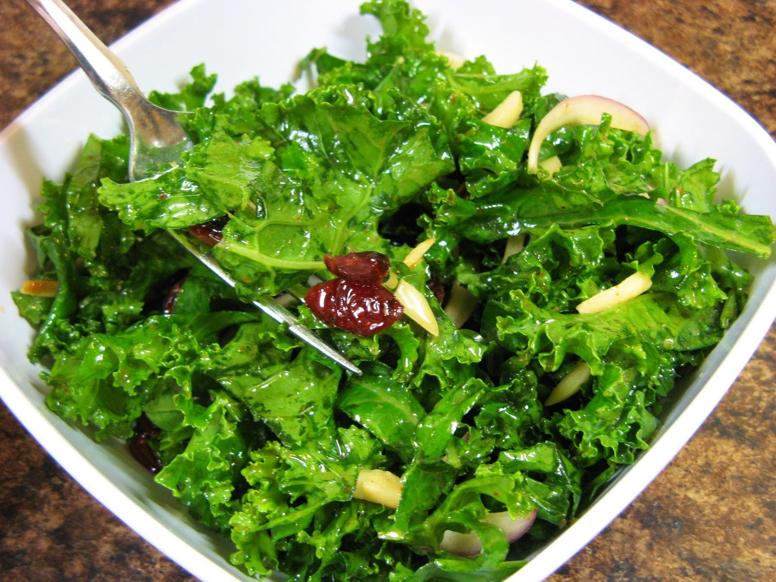 The Well-Fed Newlyweds: Raw Kale Salad with Almonds and Cranberries