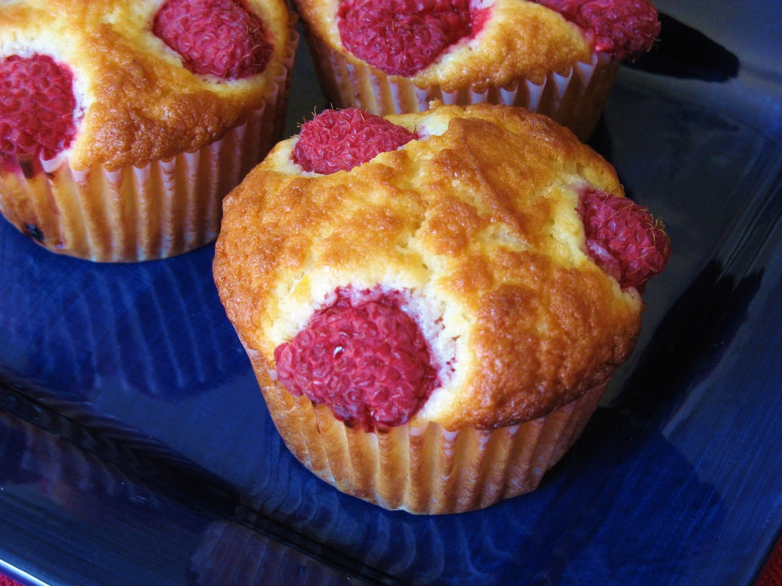 The Well-Fed Newlyweds: Raspberry-Topped Lemon Muffins