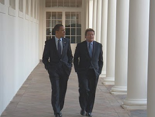 President Barack Obama and correspondent Steve Kroft walk along one of the White House's colonnades on Friday, March 20, 2009