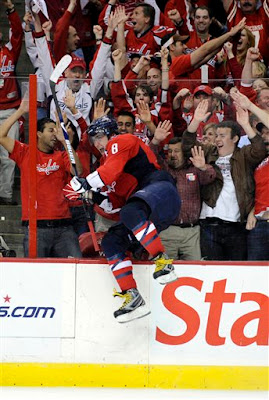 Alex Ovechkin, from Russia, leaps against the glass after scoring his third goal of the game against the Pittsburgh Penguins during the third period of Game 2