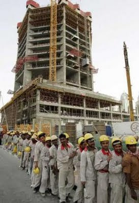 Dubai: Workers wait for a bus