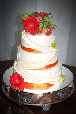 Wedding cake with fondant swags and fresh flowers