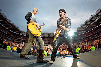 U2's Adam Clayton, left, and The Edge
