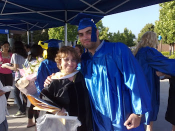 Picture of me with a former student, Tarek, at his graduation last spring