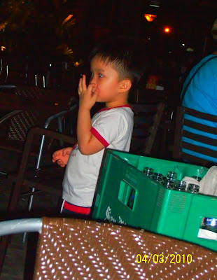 boy preschooler picking his nose in public