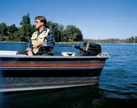 boater using an Outboard tiller extension handle
