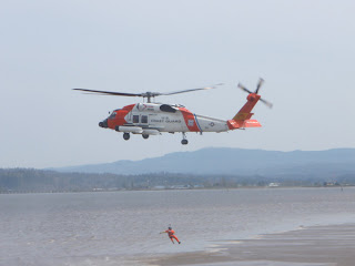 Coast Guard Helicopter Practicing rescue maneuvers in Astoria, Oregon near Columbia River Bar
